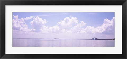 Framed Sea with a container ship and a suspension bridge in distant, Sunshine Skyway Bridge, Tampa Bay, Gulf of Mexico, Florida, USA Print