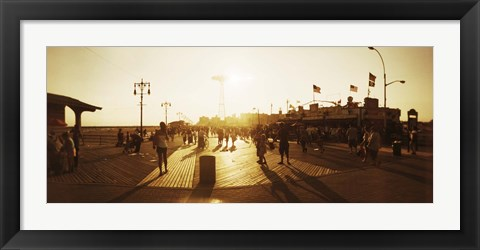 Framed Tourists walking on a boardwalk, Coney Island Boardwalk, Coney Island, Brooklyn, New York City, New York State, USA Print