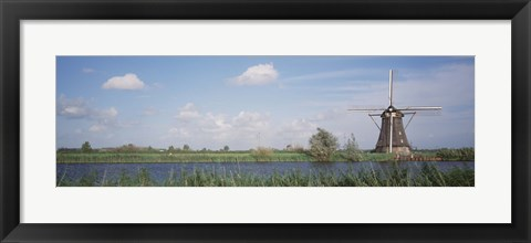 Framed Netherlands, Traditional windmill in the village Print