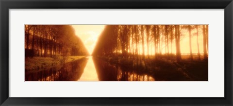 Framed Belgium, tree lined waterway through countryside, sepia tone Print