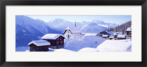 Framed Snow Covered Chapel and Chalets Swiss Alps Switzerland Print