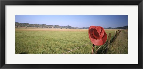 Framed USA, California, Red cowboy hat hanging on the fence Print