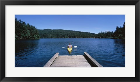 Framed Rear view of a man on a kayak in a river, Orcas Island, Washington State, USA Print