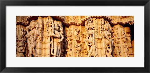 Framed Sculptures carved on a wall of a temple, Jain Temple, Ranakpur, Rajasthan, India Print
