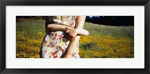 Framed Mid section view of a girl hugging her mother in a field, Marin County, California, USA Print
