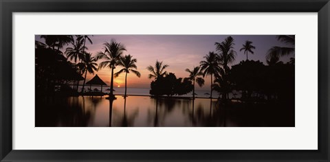 Framed Sunset over hotel pool, Lombok, West Nusa Tenggara, Indonesia Print