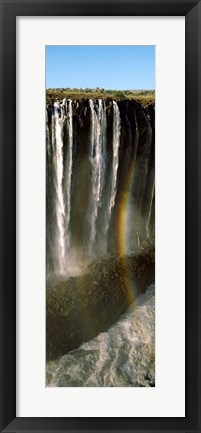 Framed Rainbow forms in the water spray in the gorge at Victoria Falls, Zimbabwe Print