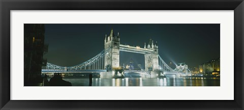 Framed Low angle view of a bridge lit up at night, Tower Bridge, London, England Print