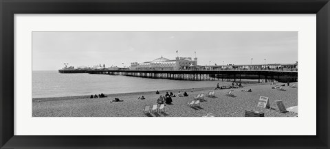 Framed Tourists on the beach, Brighton, England Print