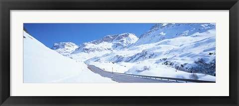 Framed Snow covered mountains on both sides of a road, St Moritz, Graubunden, Switzerland Print