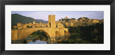 Framed Arch bridge across a river in front of a city, Besalu, Catalonia, Spain Print