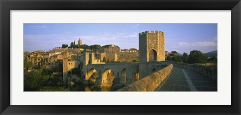 Framed Footbridge across a river in front of a city, Besalu, Catalonia, Spain Print