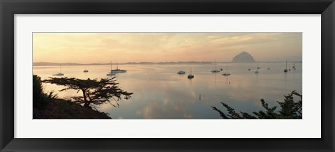 Framed Boats in a bay with Morro Rock in the distance, Morro Bay, San Luis Obispo, California, USA Print