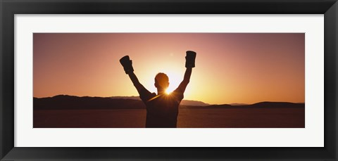 Framed Silhouette of a person wearing boxing gloves in a desert at dusk, Black Rock Desert, Nevada, USA Print