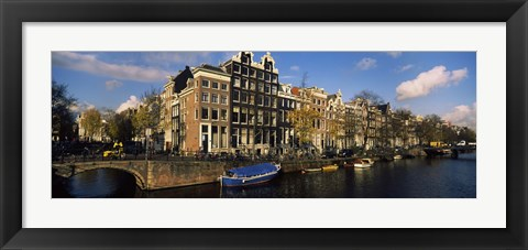 Framed Boats and Buildings along a canal, Amsterdam, Netherlands Print