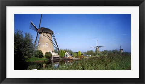 Framed Traditional windmills in a field, Netherlands Print
