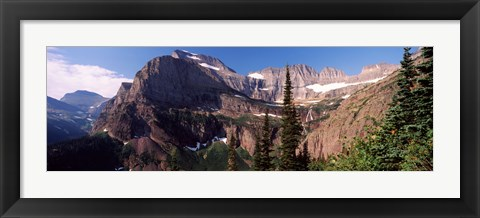 Framed Trees with a mountain range in the background, US Glacier National Park, Montana, USA Print
