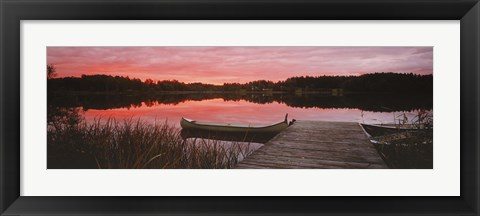 Framed Canoe tied to dock on a small lake at sunset, Sweden Print