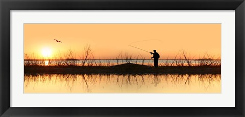 Framed Silhouette of a man fishing Print