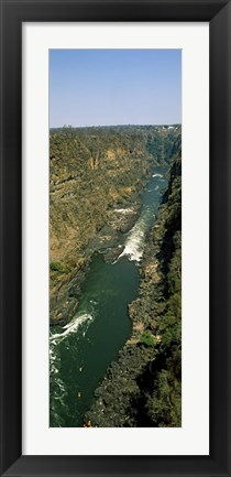 Framed Kayakers paddle down the Zambezi gorge away from the Victoria Falls, Zambia Print