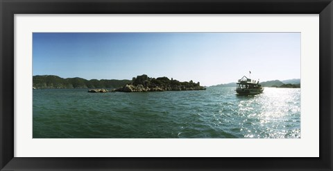 Framed Rocky island and boat in the Mediterranean sea, Sunken City, Kekova, Antalya Province, Turkey Print