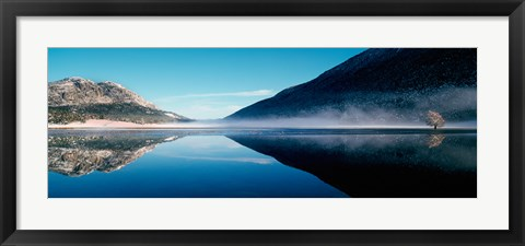 Framed Reflection of a mountain with snowy trees on a lake in winter afternoon, Cote d'Azur, France Print
