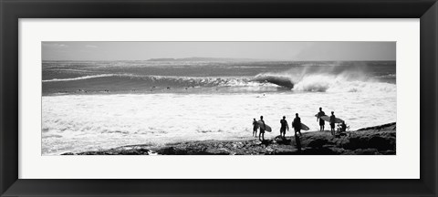Framed Silhouette of surfers standing on the beach, Australia (black and white) Print