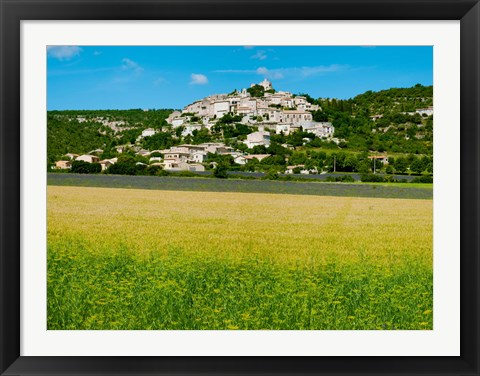 Framed Farm with a town in the background, Simiane-La-Rotonde, Alpes-de-Haute-Provence, Provence-Alpes-Cote d'Azur, France Print