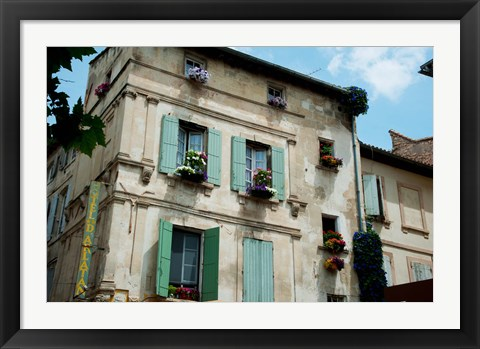 Framed View of an old building with flower pots on each window, Rue Des Arenes, Arles, Provence-Alpes-Cote d'Azur, France Print