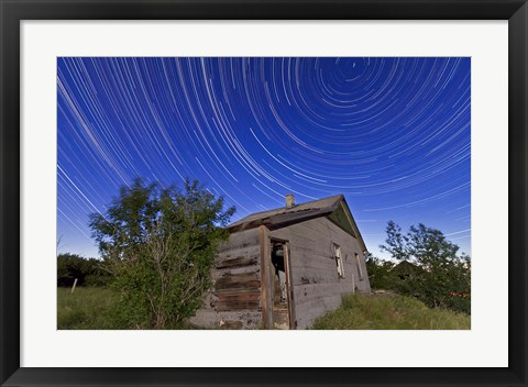 Framed Circumpolar star trails above an old farmhouse in Alberta, Canada Print