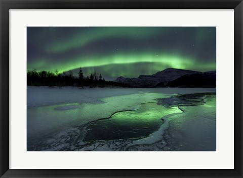 Framed Reflected aurora over a frozen Laksa Lake, Nordland, Norway Print