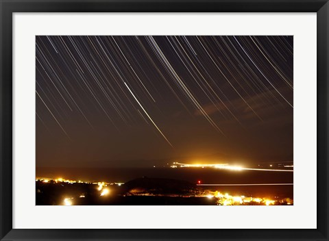 Framed Star trails above a village in the central desert of Iran Print