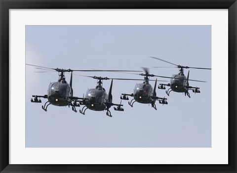 Framed Serbian Air Force Soko SA-342L GAMA choppers in flight over Serbia Print
