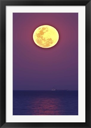 Framed Thunder's Moon and its reflection above the water Print