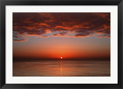 Framed layer of clouds is lit by the rising sun over Rio de la Plata, Buenos Aires, Argentina Print