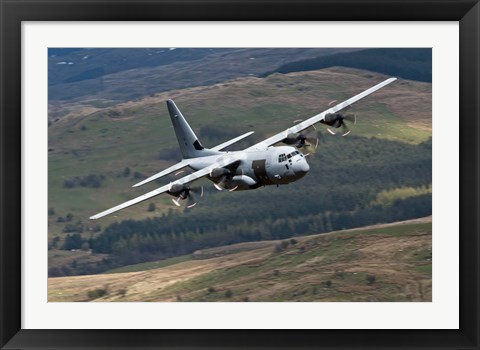 Framed C-130 Hercules of the Royal Air Force flying over North Wales Print