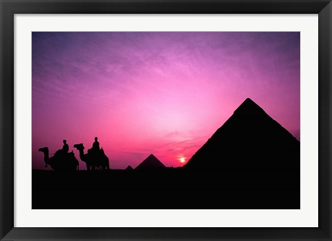 Framed Colorful Sunset Silhouetting Men and Camels at the Great Pyramids of Giza, Egypt Print