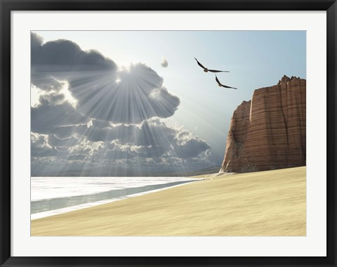 Framed Sunlight shines down on two birds flying near a cliff by the ocean Print