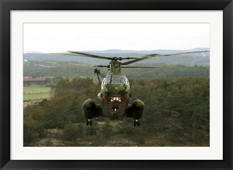 Framed Backside view of an A CH-46 Sea Knight helicopter Print