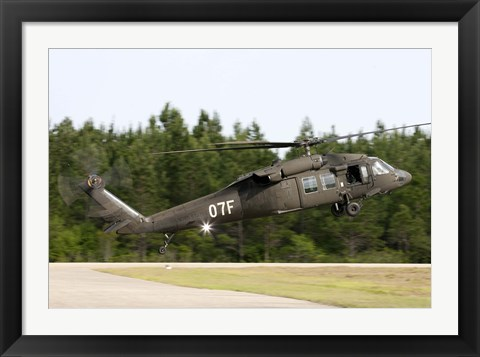 Framed US Army UH-60L Blackhawk helicopter landing at Florida Airport Print