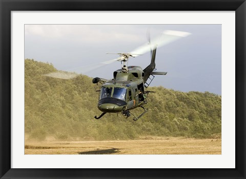 Framed Italian Air Force AB-212 ICO helicopter departs the landing zone, Italy Print