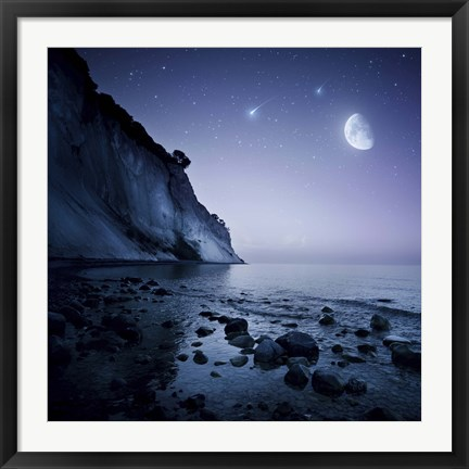 Framed Rising moon over ocean and mountains against starry sky Print