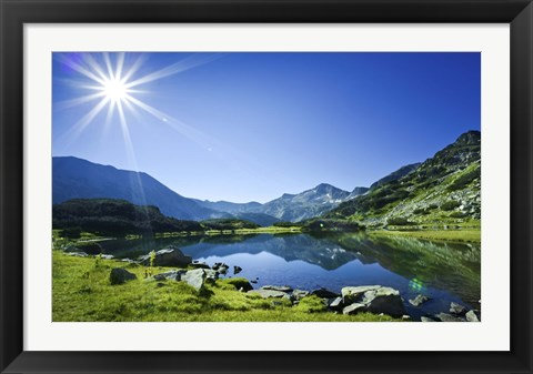 Framed Muratov Lake against blue sky and bright sun in Pirin National Park, Bulgaria Print