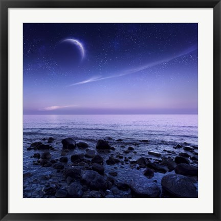 Framed Moon rising over rocky seaside against starry sky Print