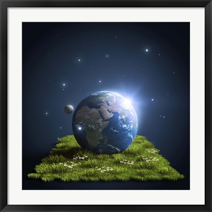 Framed Planet Earth lying on a green lawn with moon and stars Print