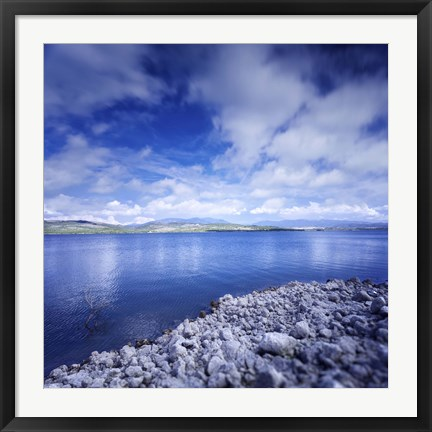 Framed Tranquil lake and rocky shore against cloudy sky, Sardinia, Italy Print