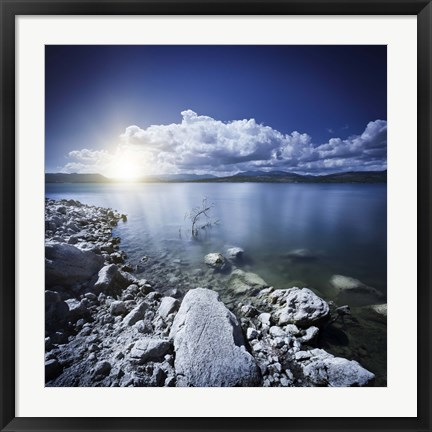 Framed Tranquil lake and rocky shore with sun over horizon, Sardinia, Italy Print