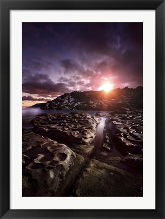 Framed Rocky shore and tranquil sea against cloudy sky at sunset, Sardinia, Italy Print
