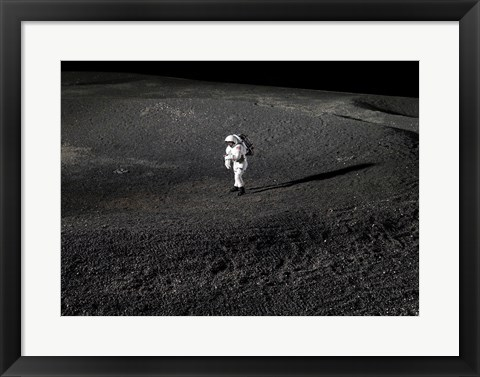 Framed Space Suit engineer simulates work inside a crater in Johnson Space Center's Lunar Yard Print