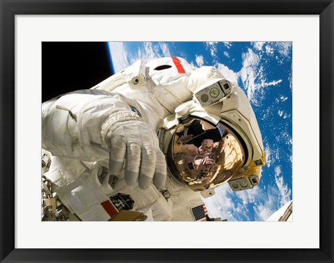 Framed Astronaut taking a spacewalk Print